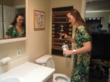 A housewife uses Listerine to clean a clog out of her toilet, besides cleaning her teeth